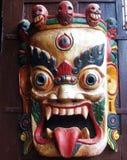 Tibetan Buddhist Wrathful Deity Mask. On display outside a cafe in Boudhanath, Kathmandu, Nepal Stock Photos