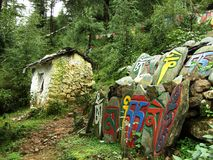 Tibetan carved stones along the path in Dharamsala, India royalty free stock photography