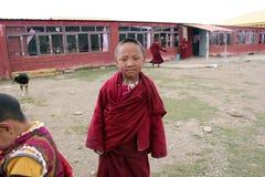 Tibetan child monks smiling to the camera. stock photos