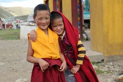 Tibetan child monks smiling to the camera. stock images
