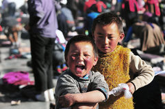 Tibetan children brothers with Pilgrims Stock Photography