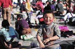 Tibetan children with Pilgrims. A Tibetan boy at Lhasa,Jokhang Temple Stock Photo