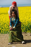 Tibetan children in rape seed field Stock Photo