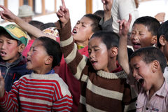 Tibetan children singing Stock Photo