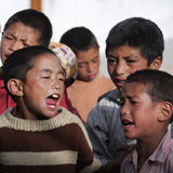 Tibetan children singing Stock Photos