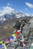 Prayer flags in Nepal trekking at Himalaya mountains. Tibetan colorful prayer flags in Nepal trekking at Himalaya mountains snow summits stock photo