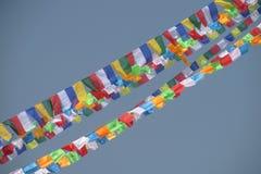 Prayer flags in Nepal trekking at Himalaya mountains. Tibetan colorful prayer flags in Nepal trekking at Himalaya mountains snow summits stock image