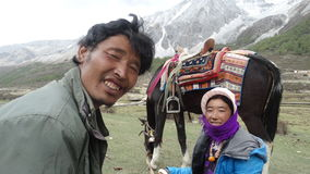 Tibetan couple with their donkey, Sichuan, China Royalty Free Stock Photo