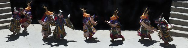 Tibetan dance of Buddhist Lama in Masks Yellow Reindeer and Blue Reindeer, Himalayas, Northern India, photo panorama. Tibetan dance of Buddhist Lama in Masks Royalty Free Stock Photos