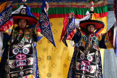 Tibetan dancers performing on stage Stock Image