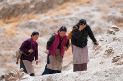 Tibetan devotees hike a holy mountain Stock Photos