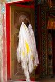 Tibetan door with hada scarf Royalty Free Stock Photos