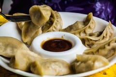 Tibetan Dumplings with souse Stock Photos