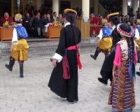 Tibetan Exiles in India Celebrate Dalai Lama's Birthday. Colorful traditional ethnic costumes of Tibet worn by group performing dance at Dalai Lama birthday Royalty Free Stock Photos