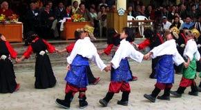 Tibetan Exiles in India Celebrate Dalai Lama's Birthday. Group of children in colorful traditional Tibetan ethnic costume present dance performance at Dalai Lama Stock Images