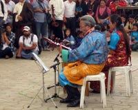 Tibetan Exiles in India Celebrate Dalai Lama's Birthday. Man and woman in colorful traditional Tibetan ethnic costume give musical performance at Dalai Lama Stock Images