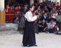 Tibetan Exiles in India Celebrate Dalai Lama's Birthday. Woman in traditional ethnic costume of Tibet performs song at Dalai Lama birthday celebrations Stock Photo