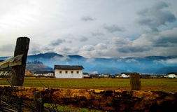 Tibetan farm. With mountian and clouds in background,Yunnan,china Royalty Free Stock Photos