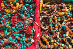 Tibetan fashion accessories in a market in Tibet. Close-up of Tibetan fashion accessories in a market in Tibet on the road to Kathmandu Royalty Free Stock Photography