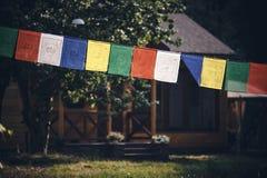 Tibetan flags closeup. Multicolored tibetan flags in the park closeup Royalty Free Stock Photos