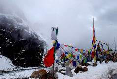 Tibetan flags in the Himalayas royalty free stock image