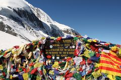 Tibetan flags at Thorong La mountain pass. The caravan of mules in mountains Tibet of Nepal Royalty Free Stock Photography