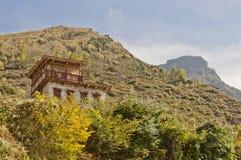 A tibetan folk house. On a hillside Stock Images