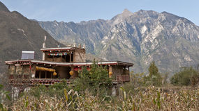 A Tibetan folk house. At the foot of mountain Royalty Free Stock Image