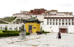 Tibetan in front of the Potala Palace. A Tibetan is walking in front of the Potala Palace.Taken in  Lhasa, capitol city of Tibet in west China,Time:2010/8/26 Royalty Free Stock Image
