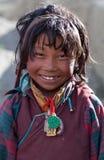 Tibetan girl. SALDANG - SEPTEMBER 06: Tibetan girl Pema Dorje, 9, from the village of refugees poses for the photo on September 06, 2011 in Saldang, Upper Dolpo Royalty Free Stock Photography