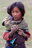 Tibetan girl. DHO TARAP - SEPTEMBER 10: Portrait of Tibetan girl with baby from the village of refugees poses for the photo on September 10, 2011 in Dho Tarap Royalty Free Stock Photos