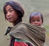 Tibetan girl. DHO TARAP - SEPTEMBER 10: Tibetan girl her brother from the village of refugees poses for the photo on September 10, 2011 in Dho Tarap, Upper Dolpo Stock Photography