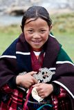 Tibetan girl. DHO TARAP, NEPAL - SEPTEMBER 11: Tibetan girl Pema Sangku, 9, from the village of refugees poses for the photo during the Dho Tarap Full Moon Royalty Free Stock Images