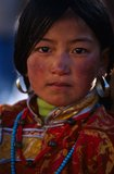 Tibetan girl. A tibetan girl with gorgeous clothes Royalty Free Stock Photo