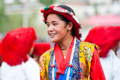 Tibetan girl, folk dancer. LEH, INDIA - SEPT 08: Young girl dancer in traditional Tibetan clothes performing folk dance. Annual Festival of Ladakh Heritage in royalty free stock photo