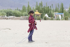 Tibetan girl jumping on a skipping rope in Druk White Lotus School. Ladakh, India Royalty Free Stock Photo