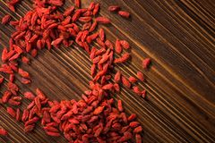 Tibetan goji berries contain many minerals. Tibetan goji berries contain many useful substances, vitamins and minerals on wooden table Royalty Free Stock Images