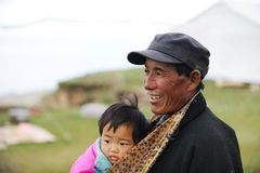 Tibetan grandpa and baby Stock Image