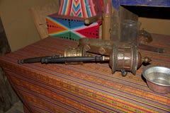 Tibetan hand prayer wheel Stock Image