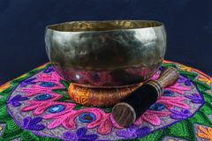 Tibetan handcrafted singing bowl on an Yoga Pillow. For massage an meditation Royalty Free Stock Images