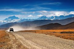Tibetan highlands. Tibetan road and mount Everest on background