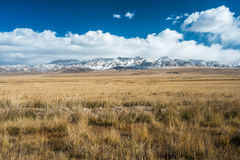 Tibetan highlands and distant snowy mountains near Daotanghe cit Stock Photos