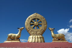 Tibetan holy symbol. Holy symbol on historic Tibetan temple roof Stock Images