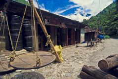 Tibetan house. Details of wooden Tibetan rural house with cloudscape in background Royalty Free Stock Photos