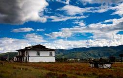 Tibetan houses near Shangri-la. Nearby mountain range Stock Photography