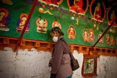 A Tibetan lady prays in Tashilompu Monastery Shigaste Tibet Royalty Free Stock Images