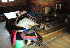 Tibetan woman traditional cooking Jiuzhaigou China Royalty Free Stock Images
