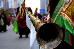 Tibetan lama blow long horn Royalty Free Stock Image