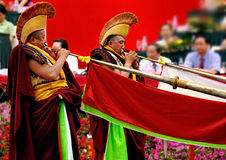 Tibetan lama blow long horn Royalty Free Stock Photos