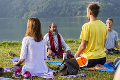 Tibetan Lama conducts classes with sunsurfers people on meditation and yoga. Pokhara, Nepal Royalty Free Stock Images